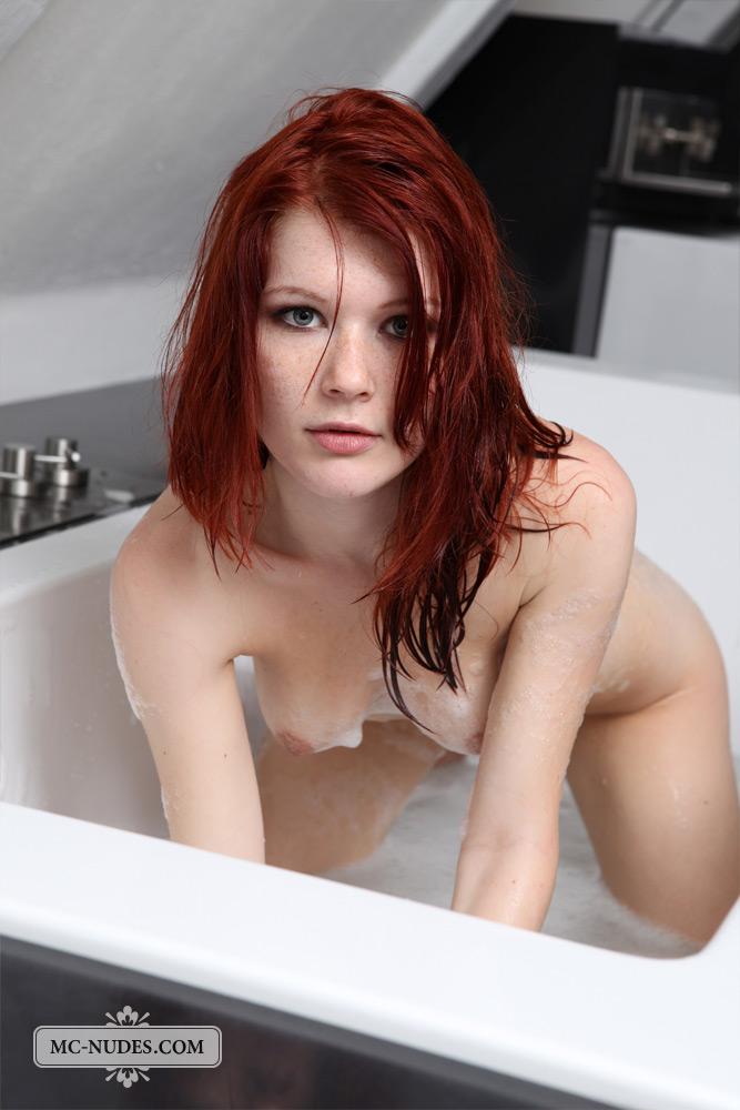 Tub bath redhead in