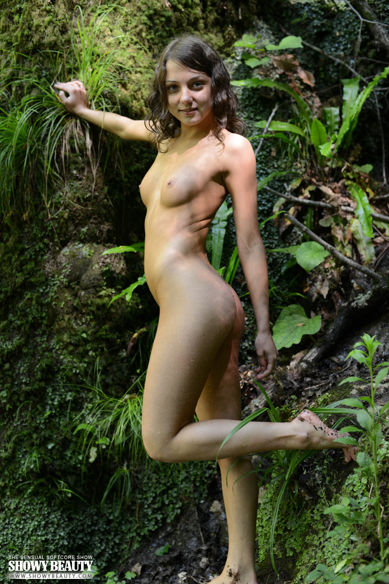 Swimming Naked at the Waterfall - NudesPuri.com