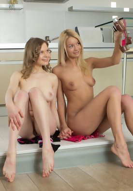 Nude women in kitchen