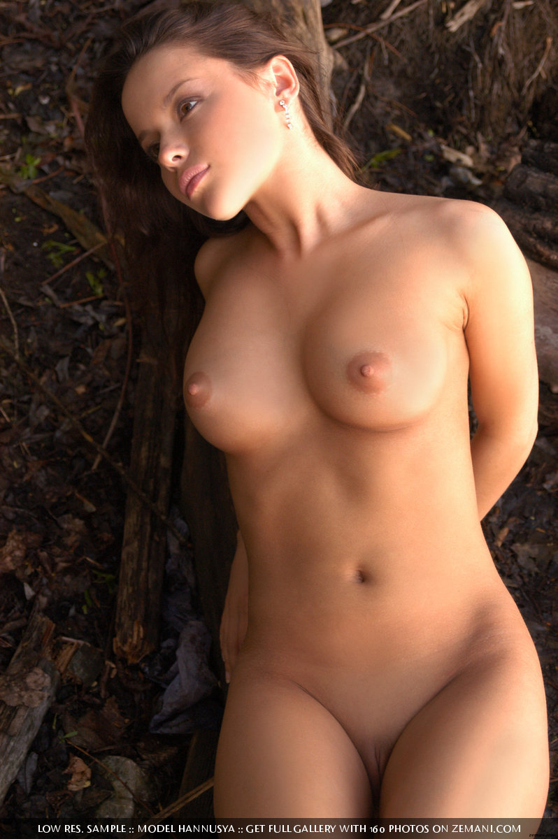 Naked coed volleyball player