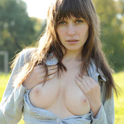 cute_brunette_stripping_in_the_field-14