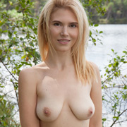 cute_blonde_topless_by_the_lake-10